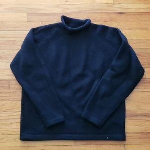 Wool rollneck sweater.